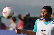 Brazilian footballer Thiago Silva takes part in a training session of the national team participating in the London Olympics, in Rio de Janeiro on July 11, 2012. The Olympic Games get underway in the British capital on July 27, with the football tournament scheduled to start two days earlier.  AFP PHOTO/VANDERLEI ALMEIDA