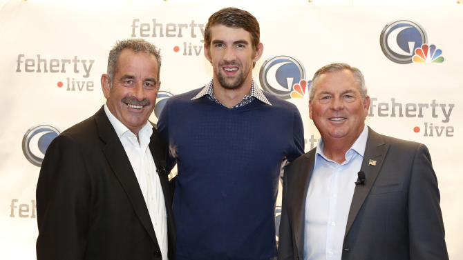 (L-R) Sam Torrance, Michael Phelps and Lanny Wadkins, are seen at Golf Channel's 'Feherty Live From the Ryder Cup', on Monday, September 24, 2012 at the Tivoli Theatre in Downers Grove, IL.  (Ross Dettman /AP Images for Golf Channel)