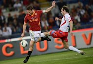 AS Roma&#39;s forward Francesco Totti (L) fights for the ball with a Catania player during an Italian Serie A football match at Rome&#39;s Olympic stadium. Roma all but crashed out of European contention with a limp performance in a 2-2 draw at home to Catania