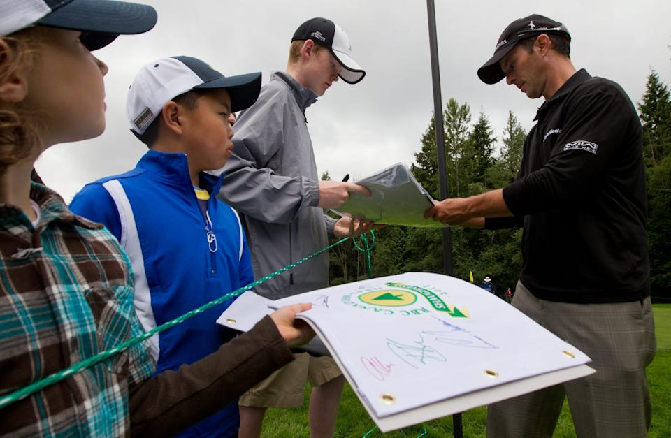 Canada's Mike Weir signs autographs for young fans after playing the 15th hole during a pro-am event at the Canadian Open golf tournament at Shaughnessy Golf and Country Club in Vancouver, British Columbia, on Wednesday, July 20, 2011. (AP Photo/The Canadian Press, Darryl Dyck)