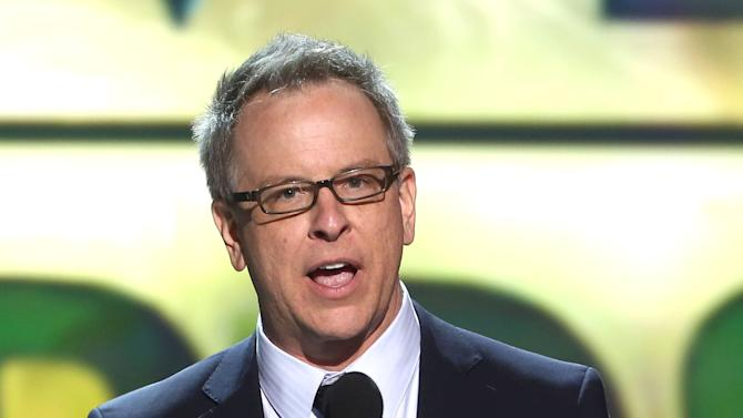 """Rich Moore accepts the award for best animated feature for """"Wreck-It Ralph"""" at the 18th Annual Critics' Choice Movie Awards at the Barker Hangar on Thursday, Jan. 10, 2013, in Santa Monica, Calif.  (Photo by Matt Sayles/Invision/AP)"""