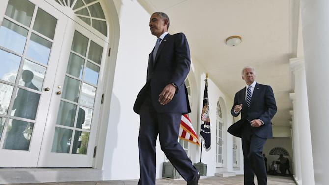 President Barack Obama walks back to the Oval Office with Vice President Joe Biden, right, after making a statement about the crisis in Syria in the White House Rose Garden in Washington Saturday, Aug. 31, 2013. Obama said he has decided that the United States should take military action against Syria in response to a deadly chemical weapons attack. But he said he will seek congressional authorization for the use of force. (AP Photo/Charles Dharapak)