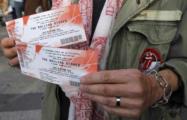 Rolling Stones fan who named himself as Patrice, 55, and who claims he has seen 54 Rolling Stones concerts, shows the tickets he bought for tonight&#39;s concert in Paris, Thursday, Oct. 25, 2012. The Rolling Stones announced a surprise &quot;warm-up gig&quot; in Paris, and within an hour the Champs Elysees was swarming with fans hoping to get satisfaction with one of the 350 tickets for the Thursday night show. (AP Photo/Francois Mori)