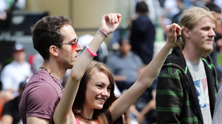 Party goers dance at the annual 4/20 marijuana festival near downtown Denver at Civic Center Park, Saturday, April 19, 2014. The two-day festival, which is expected to draw tens of thousands of people, features music, vendors and speakers in Civic Center Park in front of the state capitol building. (AP Photo/Brennan Linsley)