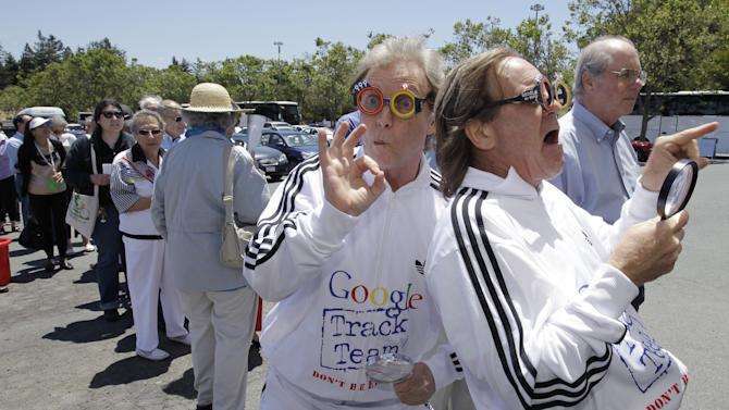 "Consumer Watchdog demonstrators Don McLeod, left, and J. Schwartz, right, protest in front of a Google shareholders outside of Google headquarters in Mountain View, Calif., Thursday, June 21, 2012 before the Google shareholders meeting. Protestors demonstrated to help raise awareness of Google's online tracking policy. They are calling for legislation for ""Do Not Track"" mechanism urged by the FTC. They are protesting information from being gathered by Google without permission.  (AP Photo/Paul Sakuma)"