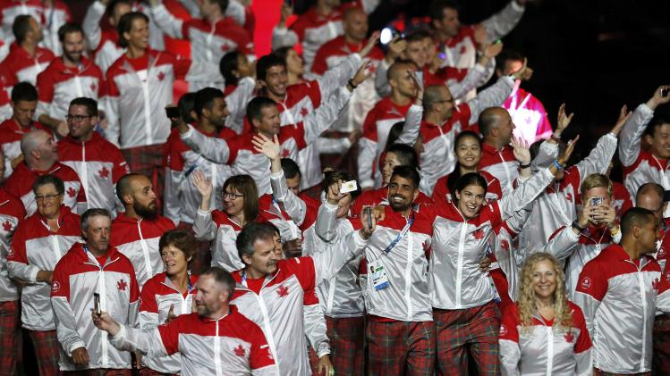 Members of the Canadian team arrive during the opening ceremony for the 2014 Commonwealth Games at Celtic Park in Glasgow, Scotland