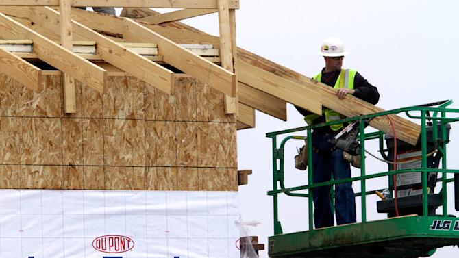 FILE - In this April 25, 2011 file photo, a construction worker builds an industrial complex in Springfield, Ill.  Chemical maker the DuPont Co. will cut 1,500 jobs and take other steps to increase competitiveness after a third quarter in which earnings fell sharply. The company reported net income of $10 million Tuesday, Oct. 23, 2012, or a penny per share, compared with $452 million, or 48 cents per share, for the same period last year. Excluding one-time items, DuPont earned 44 cents per share, compared with 69 cents per share for last year's third quarter. (AP Photo/Seth Perlman, File)