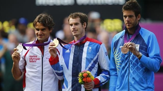 Gold medallist Andy Murray of Britain is flanked by silver medallist Roger Federer of Swizerland (L) and bronze medallist Juan Martin del Potro of Argentina during the presentation ceremony (Reuters)