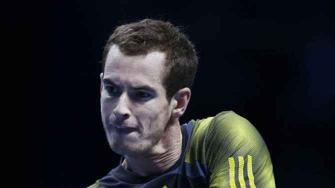 Andy Murray of Britain plays a return to Tomas Berdych of the Czech Republic, during their ATP Tennis Finals singles match, in London, Monday, Nov.  5, 2012. (AP Photo/Kirsty Wigglesworth)