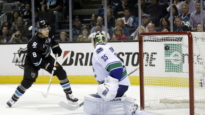 San Jose Sharks center Joe Pavelski (8) scores past Vancouver Canucks goalie Cory Schneider (35) during the first period of Game 3 of their first-round NHL hockey Stanley Cup playoff series in San Jose, Calif., Sunday, May 5, 2013. (AP Photo/Marcio Jose Sanchez)