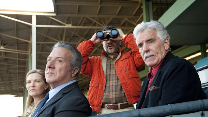 "In this undated image released by HBO, from left, Joan Allen, Dustin Hoffman, John Ortiz and Dennis Farina are shown in a scene from the HBO original series ""Luck."" A drama set at a California racetrack, HBO canceled the horse racing series after a third horse died during the production of the series. (AP Photo/HBO, Gusmano Cesaretti )"