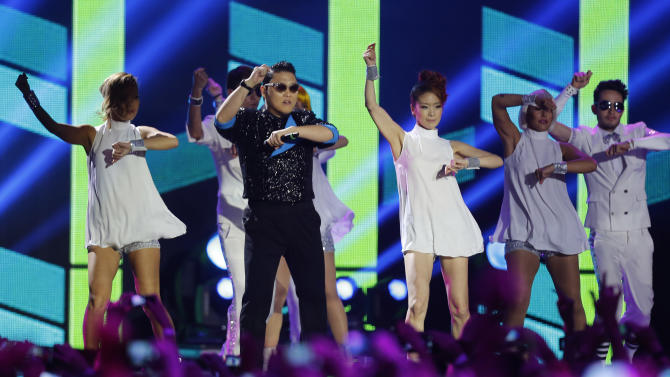 South Korean Psy performs during the 2012 MTV European Music Awards show at the Festhalle in Frankfurt, central Germany, Sunday, Nov. 11, 2012. (AP Photo/Michael Probst)