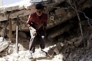 "A Syrian youth walks over the rubble of a destroyed house in Al-Bab in the northern province of Aleppo on September 1. Syrian rebels launched deadly attacks on the military in a campaign increasingly targeting its air power, as President Bashar al-Assad's traditional ally Russia said it was ""naive"" to expect him not to fight back"