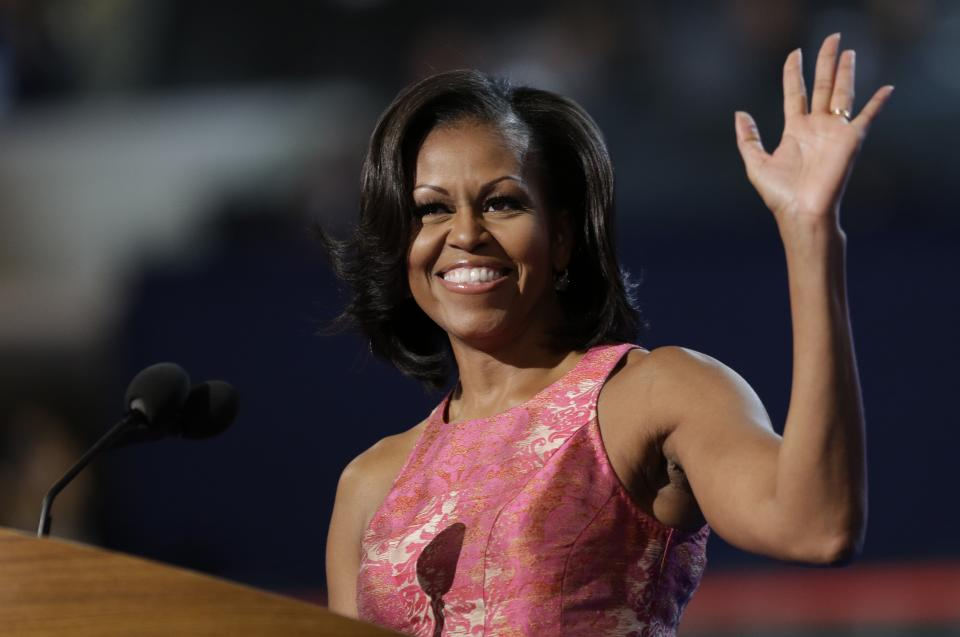 First Lady Michelle Obama waves to delegates at the Democratic National Convention in Charlotte, N.C., on Monday, Sept. 3, 2012. (AP Photo/David Goldman)