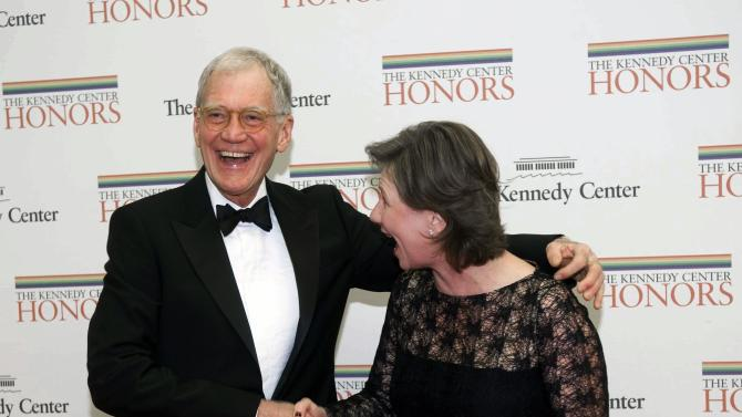 2012 Kennedy Center Honoree comedian David Letterman shakes hands with his wife Regina as they arrive at the State Department for the Kennedy Center Honors Gala Dinner on Saturday, Dec. 1, 2012 in Washington. (AP Photo/Kevin Wolf)