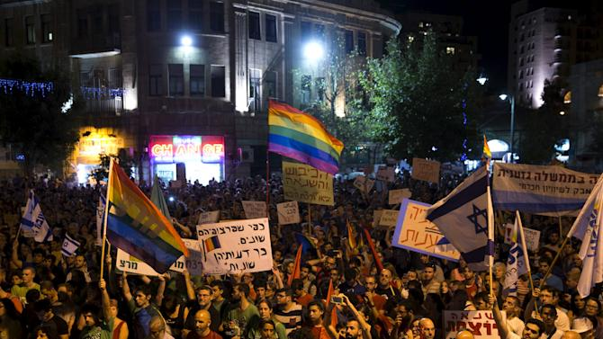 People take part in a rally to condemn an attack on the annual Gay Pride parade in Jerusalem