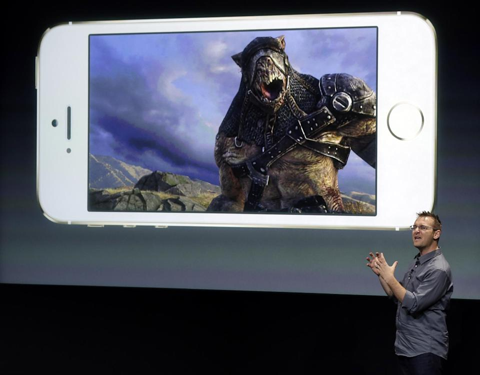 Donald Mustard, CEO of Epic Games, speaks on stage during the introduction of the new iPhone 5s in Cupertino, Calif., Tuesday, Sept. 10, 2013. (AP Photo/Marcio Jose Sanchez)