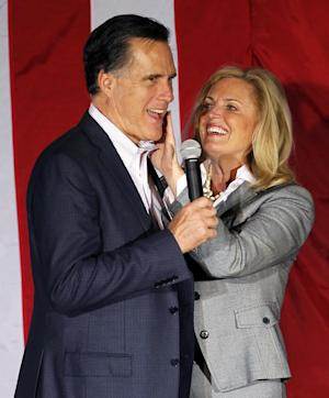 Ann Romney, wife of Republican presidential candidate, former Massachusetts Gov. Mitt Romney, wipes lipstick off his face after kissing him at a campaign rally in Zanesville, Ohio, Monday, March 5, 2012. (AP Photo/Gerald Herbert)
