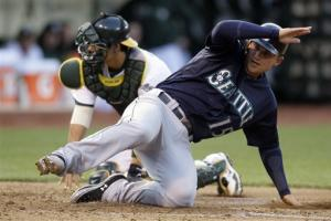Mariners survive late rally to beat A's 8-7