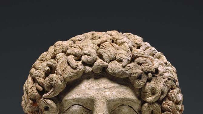 This undated image provided by the J. Paul Getty Museum shows a terracotta head depicting the Greek god Hades. The museum plans to return the head to Sicily after determining it was clandestinely excavated from an archaeological site in the 1970s. The museum took initiative to investigate the piece's origins after seeing fragments in a publication that could join to the head, which dates to about 400 to 300 B.C., according to Timothy Potts, the museum's director. The Getty procured the piece in 1985. (AP Photo/J. Paul Getty Museum)