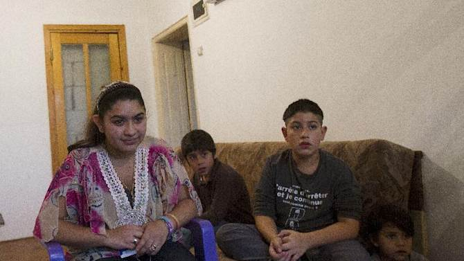 From left 15 year old Leonarda Dibrani, joined by her brothers Ronaldo 9, Roki 11, Masar 5, expelled from France last week, during an interview for The Associated Press in a room of a shelter house in Mitrovica, northern Kosovo, Wednesday, Oct 16, 2013. France's government, trying to save face amid widespread outrage, said Wednesday that it is investigating the treatment of a 15-year-old girl of the Dibrani family who was detained by police in front of her fellow students so she and her family could be expelled to Kosovo as illegal immigrants. (AP Photo/Visar Kryeziu)
