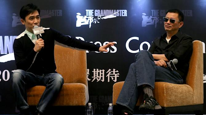 "Tony Leung, left, speaks while movie director Wong Kar-wai listens during a press conference on Wednesday, Jan. 23, 2013 in Singapore. For a director and actor who have worked together for about two decades, there did not seem to be much chemistry between Wong and Leung at the news conference promoting their new movie ""The Grandmaster."" (AP Photo/Wong Maye-E)"
