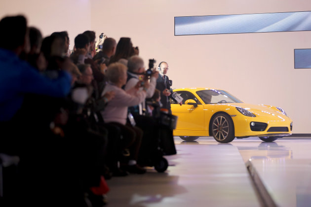The new Porsche Cayman is introduced at the LA Auto Show in Los Angeles, Wednesday, Nov. 28, 2012. The annual Los Angeles Auto Show opened to the media Wednesday at the Los Angeles Convention Center.