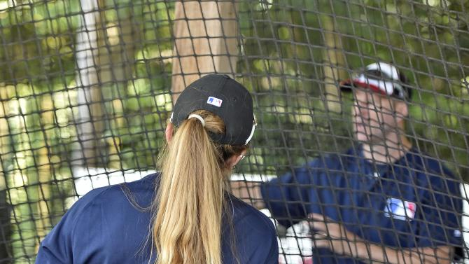 Melissa Mayeux listens to a coach at a baseball camp in Paderborn, Germany, Wednesday, July 1, 2015. (AP Photo/Martin Meissner)