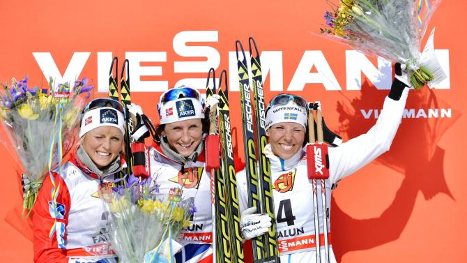 On the podium are Norway's Marit Bjorgen, centre, winner of the women's 10km pursuit during the FIS Cross-Country World Cup Final in Falun, Sweden, Sunday March 24, 2013, with 2nd placed Norway's Therese Johaug, left, and Sweden's 3rd laced Charlotte Kalla, right.  (AP Photo / ANDERS WIKLUND,  SCANPIX)   SWEDEN OUT