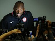 Kobe Bryant of the US basketball national team attends a press conference in London. LeBron James,Bryant and other NBA stars are pleading their case to keep the Olympics from becoming a 23-and-under event but there are indications the superstars&#39; advice is falling upon deaf ears