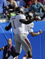 Mississippi State wide receivers Arceto Clark (19) and Chad Bumphis (1) celebrate Clark&#39;s touchdown catch against Northwestern during the first half of the Gator Bowl NCAA college football game, Tuesday, Jan. 1, 2013, in Jacksonville, Fla. (AP Photo/Stephen Morton)