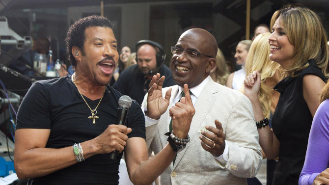 "Lionel Richie, left, sings with Al Roker and Savannah Guthrie while performing on NBC's ""Today"" show on Thursday, Aug. 16, 2012 in New York. (Photo by Charles Sykes/Invision/AP)"