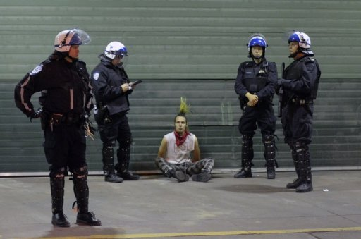 <p>A student sits on the ground after being arrested by police in Montreal. Small groups of protesters clashed with police on the streets of Montreal amid festivities leading up to Sunday's Formula One Grand Prix</p>