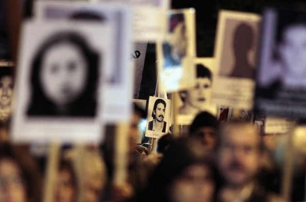 Uruguayans display pictures of relatives who &quot;disappeared&quot; during the military regime, at an annual demonstration in Montevideo