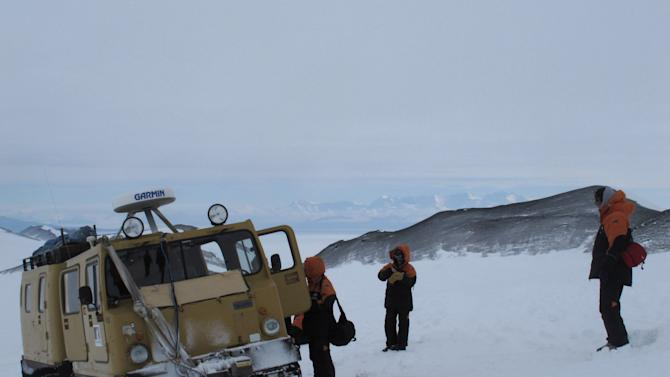 "In this Sunday, Jan. 20, 2013 photo, sightseers board an over-snow vehicle on Hut Point Peninsula of Ross Island in Antarctica. Tourism in Antarctica is rebounding five years after the financial crisis stifled what had been a burgeoning industry. Tourism is rebounding here five years after the financial crisis stifled what had been a burgeoning industry. And it's not just retirees watching penguins from the deck of a ship. Visitors are taking tours inland and even engaging in ""adventure tourism"" like skydiving and scuba diving under the ever-sunlit skies of a Southern Hemisphere summer.  (AP Photo/Rod McGuirk)"