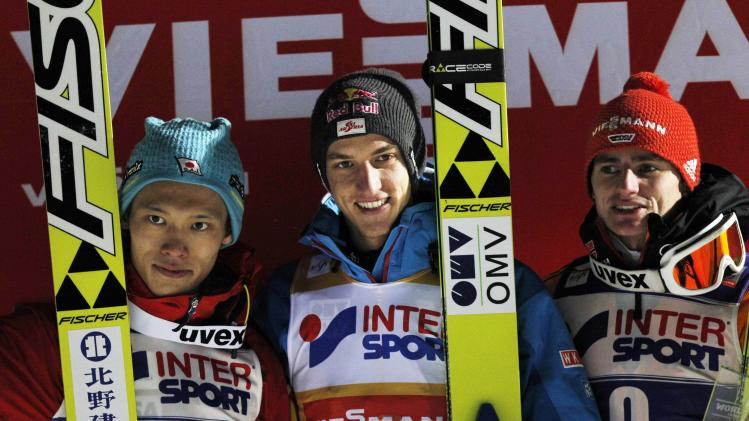 Winner Schlierenzauer of Austria, second placed Takeuchi of Japan and third placed Freitag of Germany stand on the podium after the FIS World Cup ski jumping in Lillehammer