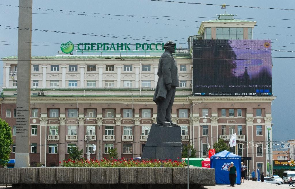 Russian giant Sberbank's profit slashed in weak economy