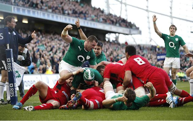 Ireland's Cian Healy, centre left, reacts after Chris Henry scored a try against Wales during their Six Nations Rugby Union international match at the Aviva Stadium, Dublin, Ireland, Saturday, Feb