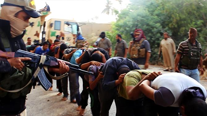 An image uploaded on June 14, 2014 on the jihadist website Welayat Salahuddin allegedly shows militants of the Islamic State of Iraq and the Levant (ISIL) capturing dozens of Iraqi security forces members in Salaheddin province