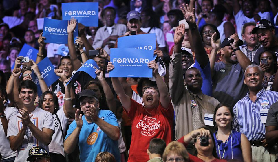 Supporters react as President Barack Obama speaks at a campaign event at Kissimmee Civic Center, Saturday, Sept. 8, 2012, in Kissimmee, Fla. (AP Photo/Pablo Martinez Monsivais)