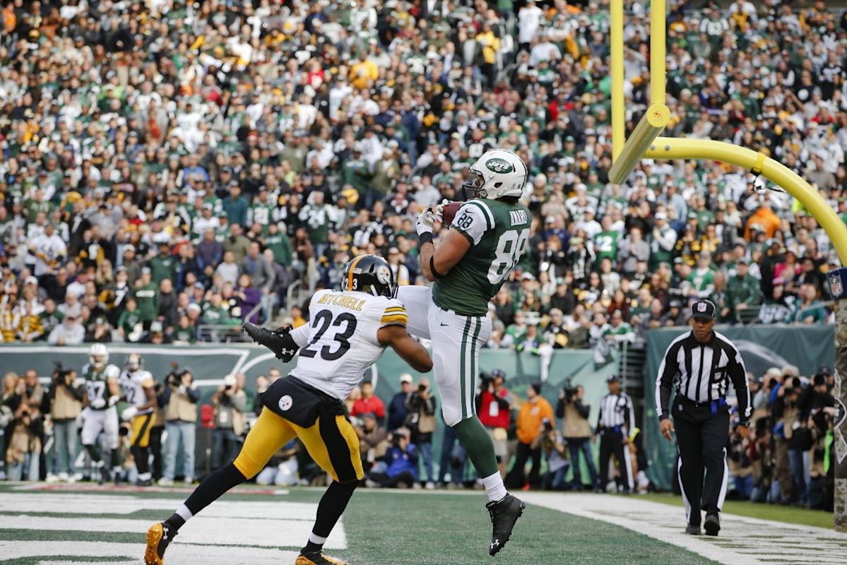 New York Jets tight end Jace Amaro (88) catches a pass for a touchdown in front of Pittsburgh Steelers' Mike Mitchell (23) during the first half of an NFL football game Sunday, Nov. 9, 2014, in East Rutherford, N.J