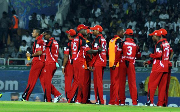 Trinidad & Tobago players celebrate after taking a wicket during the Champions League T20, 2nd match, Group B between Brisbane Heat and Trinidad & Tobago at JSCA International Cricket Stadium, Ranchi