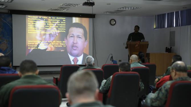 "A picture of Chavez is seen during a lecture of the academic course, ""Studies of the Thoughts of the Supreme Commander Hugo Chavez"" in Caracas"