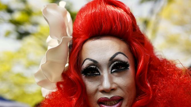 Man in drag costume poses for picture  during Tokyo Rainbow Pride parade in Tokyo