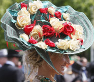 FILE - A racegoer wearing an ornate hat arrives for the third day, traditionally known as Ladies Day, of the Royal Ascot horse race meeting at Ascot, England, in this Thursday, June, 16, 2011 file photo. Organizers of the Royal Ascot race meeting say they&#39;re tightening their dress code by banning fascinators, small hats, from the royal enclosure. New rules put out by organizers Wednesday  Jan 18 2012 are the latest in a series of changes and clarifications put out by those behind the super-elite horse racing event held each June. Other rules introduced or reinforced Wednesday include the requirement that women must wear hats and clarify that dresses must fall below the knee.(AP Photo/Alastair Grant, file)