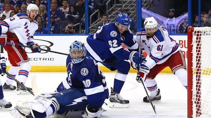Rick Nash (R) of the New York Rangers scores a goal against the Tampa Bay Lightning in Game Four of the Eastern Conference Finals during the 2015 NHL Stanley Cup Playoffs on May 22, 2015 in Tampa, Florida