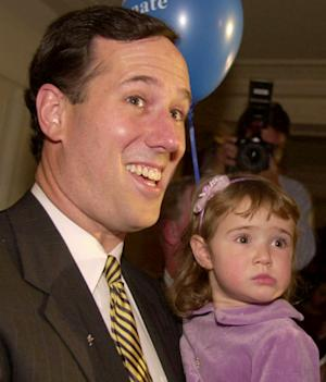 "FILE - In this Nov. 7, 2000 file photo, Sen. Rick Santorum, R-Pa., and his two-year-old daughter Sarah Maria enter a victory rally in Pittsburgh. With the Iowa presidential caucuses on Tuesday, Santorum is hoping to spring a surprise showing by casting himself as the only ""consistent conservative"" among his GOP rivals. He's been stuck at the back of the pack for months, but he's steadily visited every Iowa county and pressed for support from Republicans with doubts about the conservative credentials of other candidates, especially Mitt Romney and Newt Gingrich. (AP Photo/Gene J. Puskar, File)"