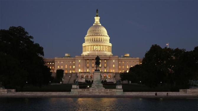 The U.S. Capitol is seen at night on the eve of a potential federal government shutdown, in Washington
