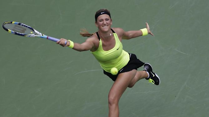 Victoria Azarenka, of Belarus, returns a shot to Samantha Stosur, of Australia, in the quarterfinals of the 2012 US Open tennis tournament, Tuesday, Sept. 4, 2012, in New York. (AP Photo/Kathy Willens)