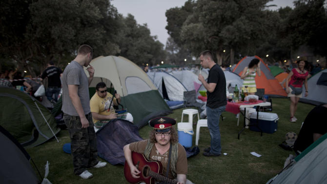 In this May. 11, 2012 photo, Russian-speaking immigrants gather for a Russian folk music festival in northern Israel. About 2,000 immigrants from the former Soviet Union attended the two-day festival, singing Russian standards, barbecuing and drinking vodka. I(AP Photo/Oded Balilty)